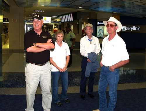Mike, Joanie, David McNerney and Don await other Recipients at DFW