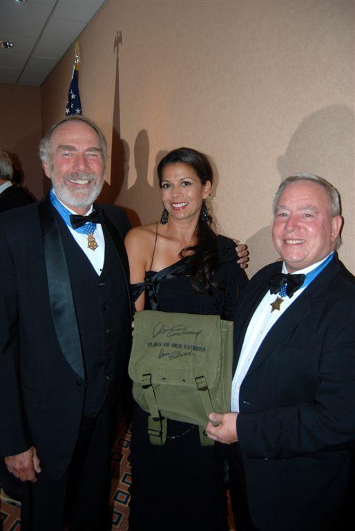 Drew Dix and Doc Ballard pose with Dina Ruiz Eastwood...